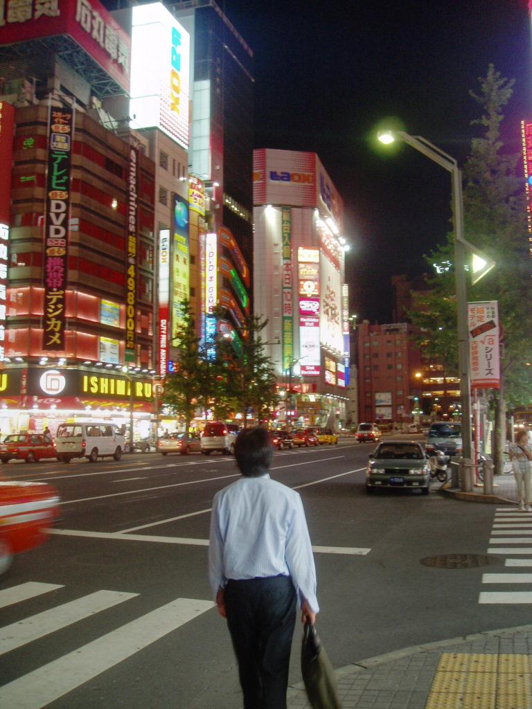 Business man walking down the street in Akihabara