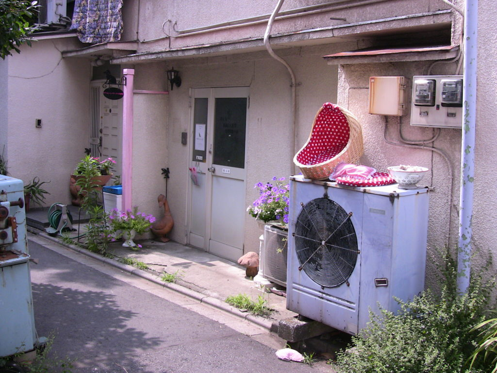 Backside of a house, large air conditioning unit