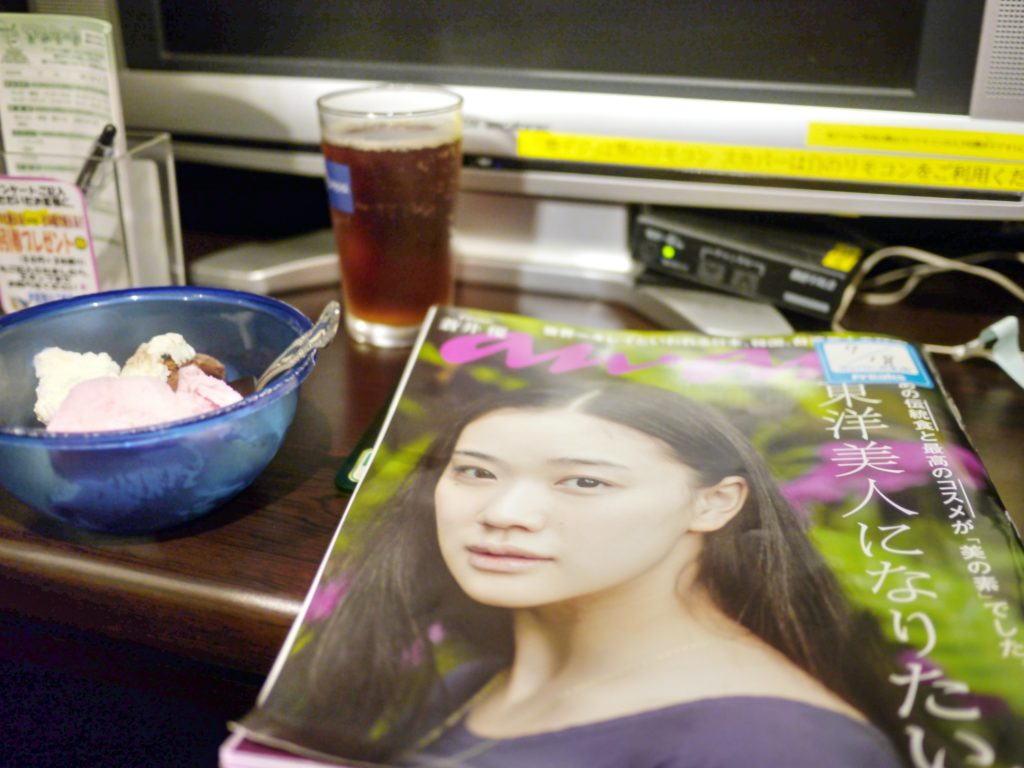 Magazine, ice cream, free soft drink on a desk