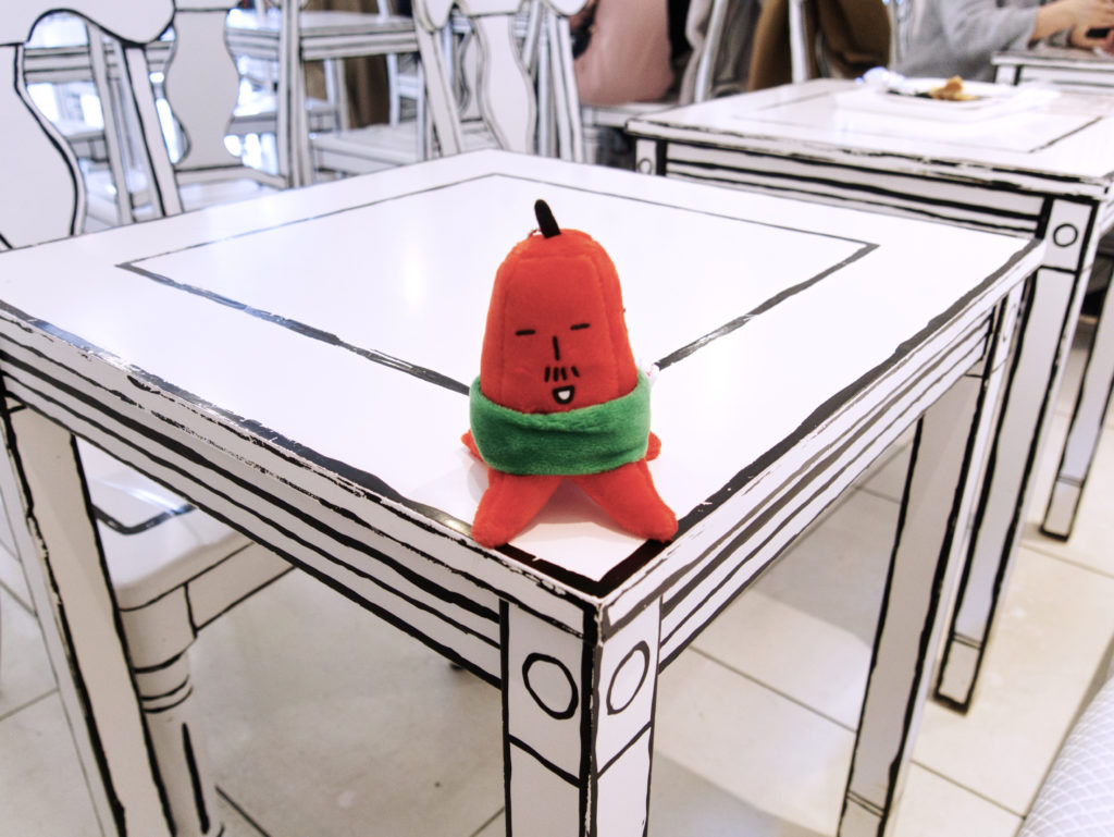 Sapporo mascot sitting on a 2D table